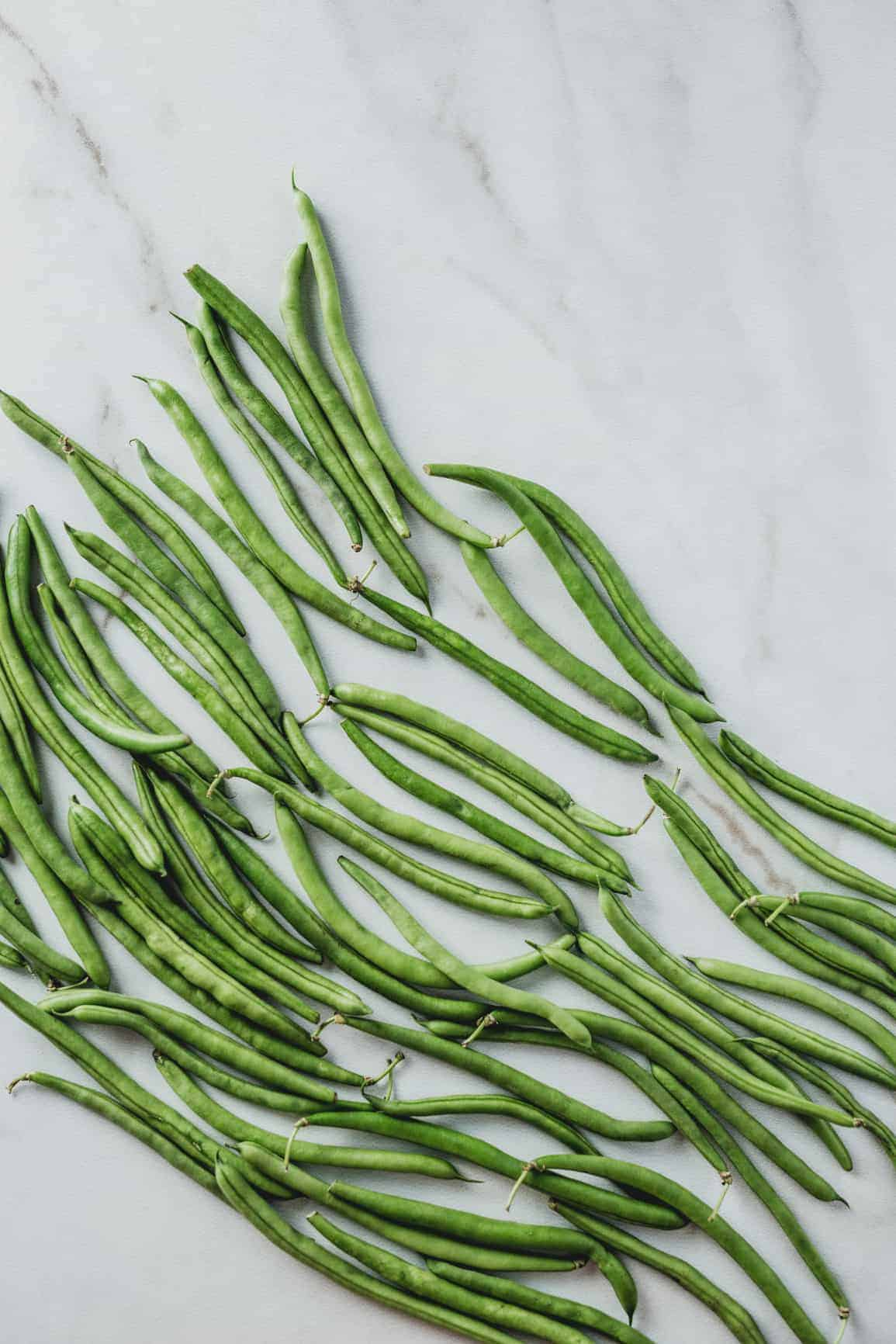 Green beans on a marble background